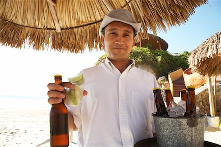 Portrait of Waiter at Beach, Mexico Stock Photo - Premium Royalty-Free, Code: 600-02121203