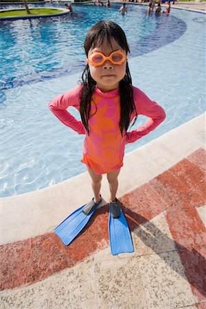Girl With Hands on Hips Next to Swimming Pool Stock Photo - Premium Royalty-Free, Code: 600-02121225