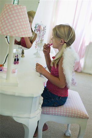Little Girl Putting On Lipstick Stock Photo - Premium Royalty-Free, Code: 600-02121630