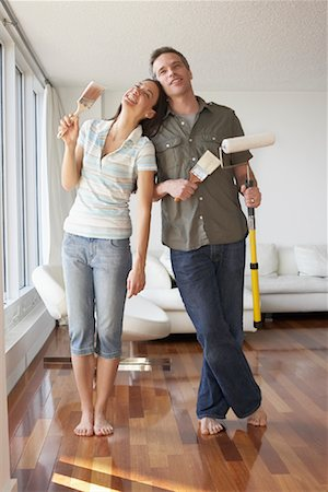 Couple in Apartment with Painting Supplies Stock Photo - Premium Royalty-Free, Code: 600-02130705