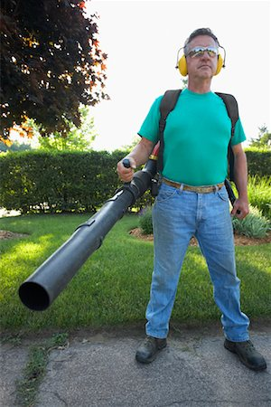 professional (pertains to traditional blue collar careers) - Man Holding Leaf Blower Stock Photo - Premium Royalty-Free, Code: 600-02156843