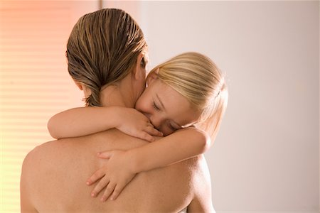 Mother Holding Sleeping Daughter Stock Photo - Premium Royalty-Free, Code: 600-02176478