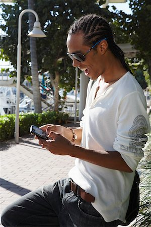 Young Man Sending a Text Message Stock Photo - Premium Royalty-Free, Code: 600-02199794
