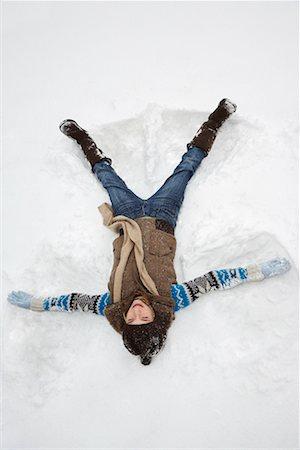Teenager Making Snow Angel Stock Photo - Premium Royalty-Free, Code: 600-02200058