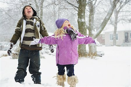 Children Catching Snowflakes on their Tongues Stock Photo - Premium Royalty-Free, Code: 600-02200102