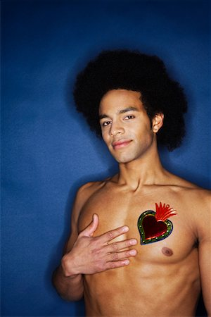 Portrait of Man With Heart on Chest Stock Photo - Premium Royalty-Free, Code: 600-02200264