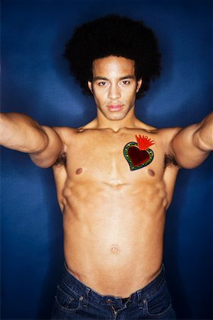 Portrait of Man With Heart on Chest Stock Photo - Premium Royalty-Free, Code: 600-02200268