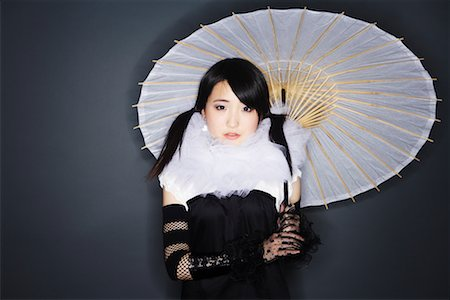 Portrait of Woman With Parasol Stock Photo - Premium Royalty-Free, Code: 600-02200277