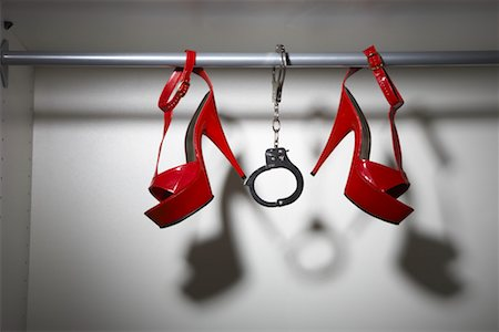 restrained - Still Life of Red Shoes and Handcuffs in Closet Stock Photo - Premium Royalty-Free, Code: 600-02200686