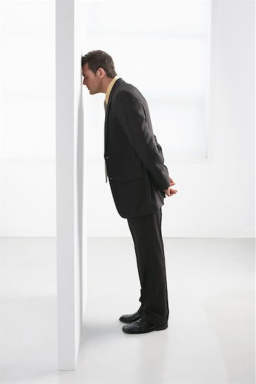 banging head against wall. Businessman Leaning on Wall