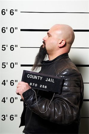 sign - Mug Shot of Man Stock Photo - Premium Royalty-Free, Code: 600-02201440