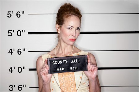 Mug Shot of Woman Stock Photo - Premium Royalty-Free, Code: 600-02201460