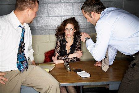 Detectives Interrogating Woman Stock Photo - Premium Royalty-Free, Code: 600-02201462