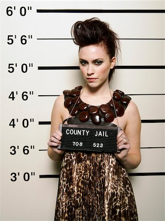 Mug Shot of Woman Stock Photo - Premium Royalty-Free, Code: 600-02201473
