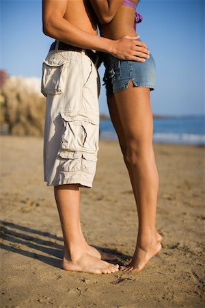 Couple Kissing on the Beach, Corona del Mar, Newport Beach, California, USA Stock Photo - Premium Royalty-Free, Code: 600-02222867