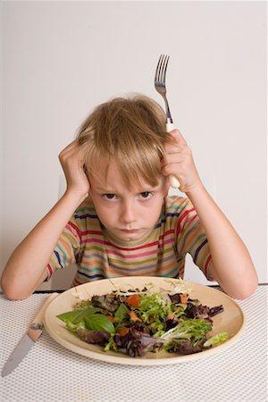 Boy Refusing to Eat Salad Stock Photo - Premium Royalty-Free, Code: 600-02222936