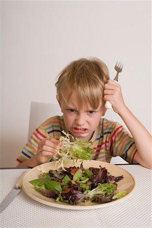 Boy Refusing to Eat Salad Stock Photo - Premium Royalty-Free, Code: 600-02222937