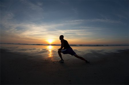 Man Stretching on Beach Stock Photo - Premium Royalty-Free, Code: 600-02222982