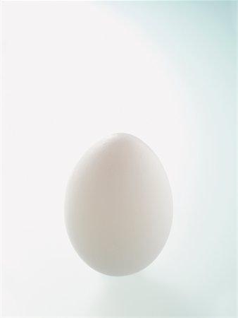 White Egg on White Background Stock Photo - Premium Royalty-Free, Code: 600-02244947