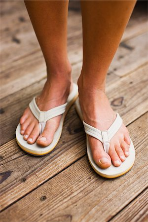 Close-up of Woman Wearing Sandals Stock Photo - Premium Royalty-Free, Code: 600-02245354