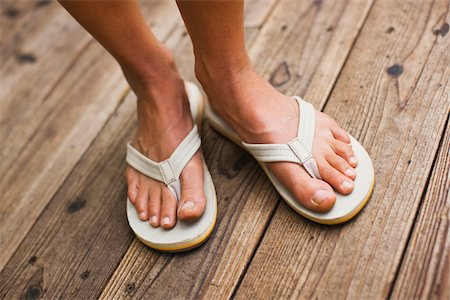 Close-up of Woman Wearing Sandals Stock Photo - Premium Royalty-Free, Code: 600-02245353