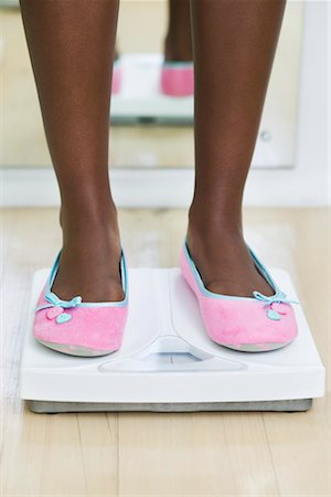 Woman's Feet on Bathroom Scale Stock Photo - Premium Royalty-Free, Code: 600-02245725