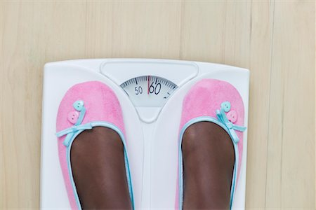 Woman's Feet on Bathroom Scale Stock Photo - Premium Royalty-Free, Code: 600-02245726