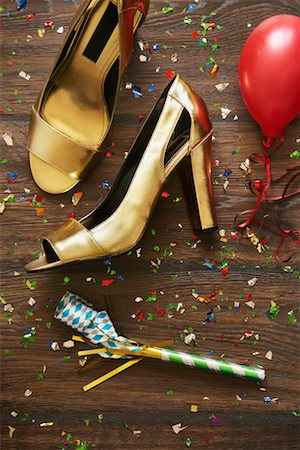 Close-up of Shoes, Noisemaker, Balloon and Confetti Stock Photo - Premium Royalty-Free, Code: 600-02264239