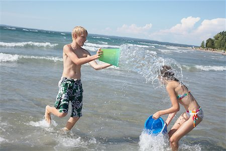Kids Playing on the Beach, Elmvale, Ontario, Canada Stock Photo - Premium Royalty-Free, Code: 600-02265291