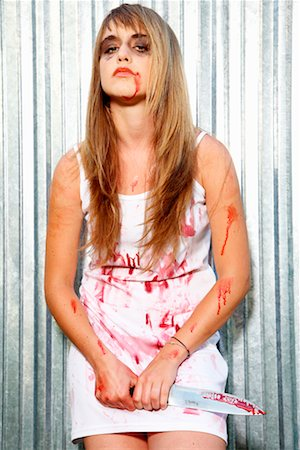 Portrait of Bloodied Woman Carrying a Butcher's Knife Stock Photo - Premium Royalty-Free, Code: 600-02289242