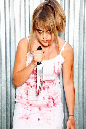 Portrait of Bloodied Woman Carrying a Butcher's Knife Stock Photo - Premium Royalty-Free, Code: 600-02289243
