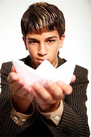 Businessman Holding Paper Stock Photo - Premium Royalty-Free, Code: 600-02289250