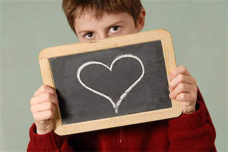 Boy Holding Chalkboard with Heart Drawn on It Stock Photo - Premium Royalty-Free, Code: 600-02346183