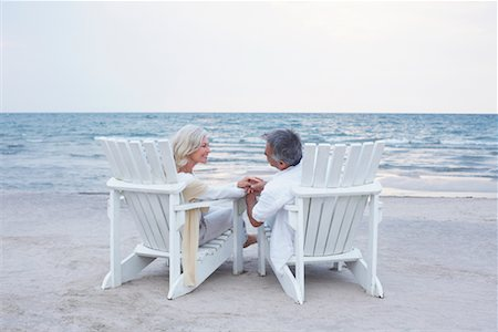Couple Sitting in Chairs on Beach Stock Photo - Premium Royalty-Free, Code: 600-02346336