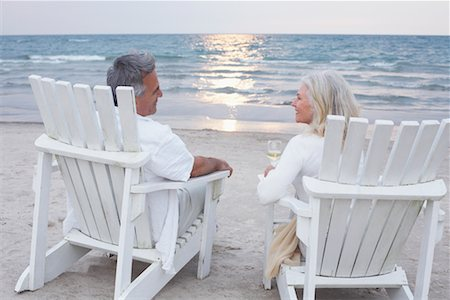 Couple Sitting in Chairs on Beach Stock Photo - Premium Royalty-Free, Code: 600-02346332