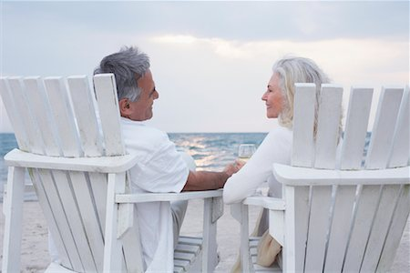 Couple Sitting in Chairs on Beach Stock Photo - Premium Royalty-Free, Code: 600-02346333