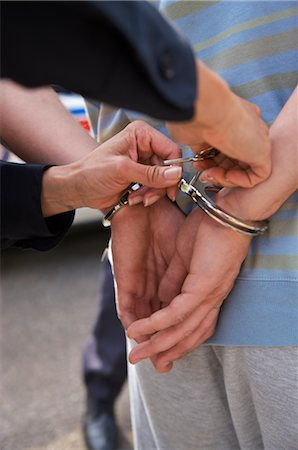 restrained - Close-up of Police Officer Handcuffing Suspect Stock Photo - Premium Royalty-Free, Code: 600-02348036