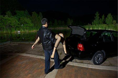 Man Disposing of Woman's Body Stock Photo - Premium Royalty-Free, Code: 600-02348074