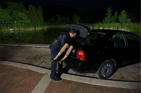 Man Disposing of Woman's Body Stock Photo - Premium Royalty-Free, Code: 600-02348075