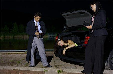 dead female body - Police Investigating a Murder Scene Stock Photo - Premium Royalty-Free, Code: 600-02348076