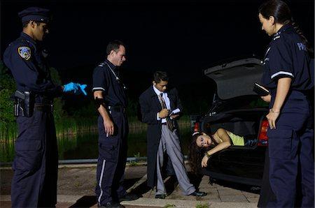 Police Investigating a Murder Scene Stock Photo - Premium Royalty-Free, Code: 600-02348077