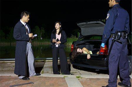 Police Investigating a Murder Scene Stock Photo - Premium Royalty-Free, Code: 600-02348078