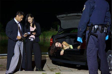 Police Investigating a Murder Scene Stock Photo - Premium Royalty-Free, Code: 600-02348079