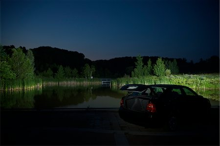 Car With Open Trunk Parked by Lake at Night Stock Photo - Premium Royalty-Free, Code: 600-02348070