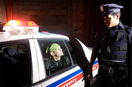 restrained - Police Officer Arresting Suspect Stock Photo - Premium Royalty-Free, Code: 600-02348096