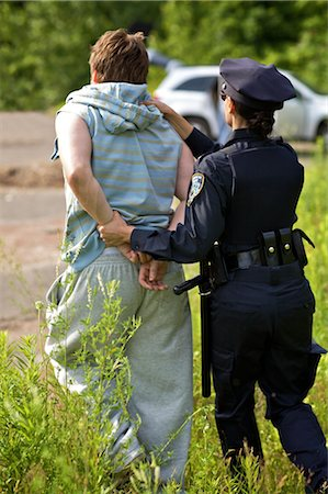 restrained - Police Officer Arresting Suspect Stock Photo - Premium Royalty-Free, Code: 600-02348122