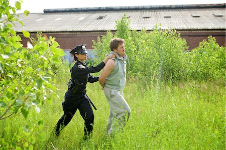 restrained - Police Officer Arresting Suspect Stock Photo - Premium Royalty-Free, Code: 600-02348148