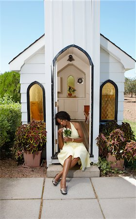 Bride Sitting on Step in Front of Chapel Stock Photo - Premium Royalty-Free, Code: 600-02376816