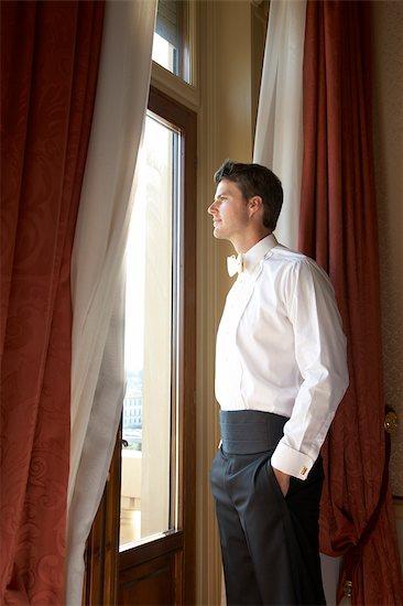 Groom Looking out Window Stock Photo - Premium Royalty-Free, Artist: Marnie Burkhart, Image code: 600-02377177