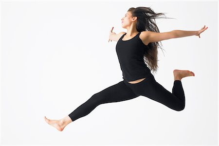 Woman Jumping in Mid-air Stock Photo - Premium Royalty-Free, Code: 600-02370942